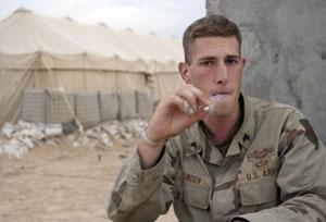 Sgt. Dave Bowden, with Alpha Company, 1st Infantry Division, smokes a cigarette in camp following the company's battle with insurgents for control of Fallujah. Paul Assaker, KRT